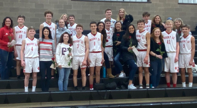 The 8th grade boys ETL team hosted a senior night celebration at their last home game of the season with coaches Robert Lowden and Keith Hennig.
